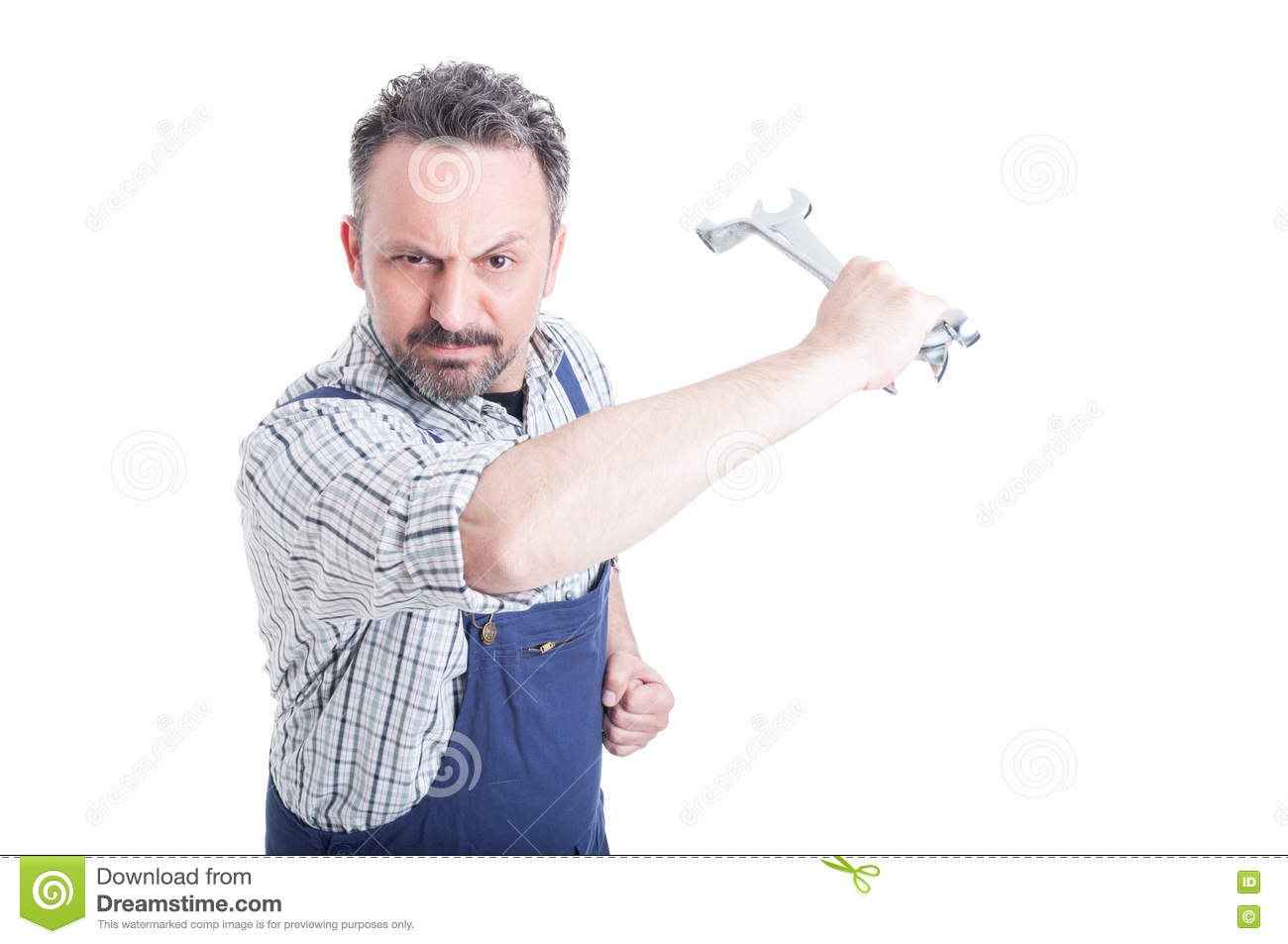 Angry mechanic acting violent with a steel wrench