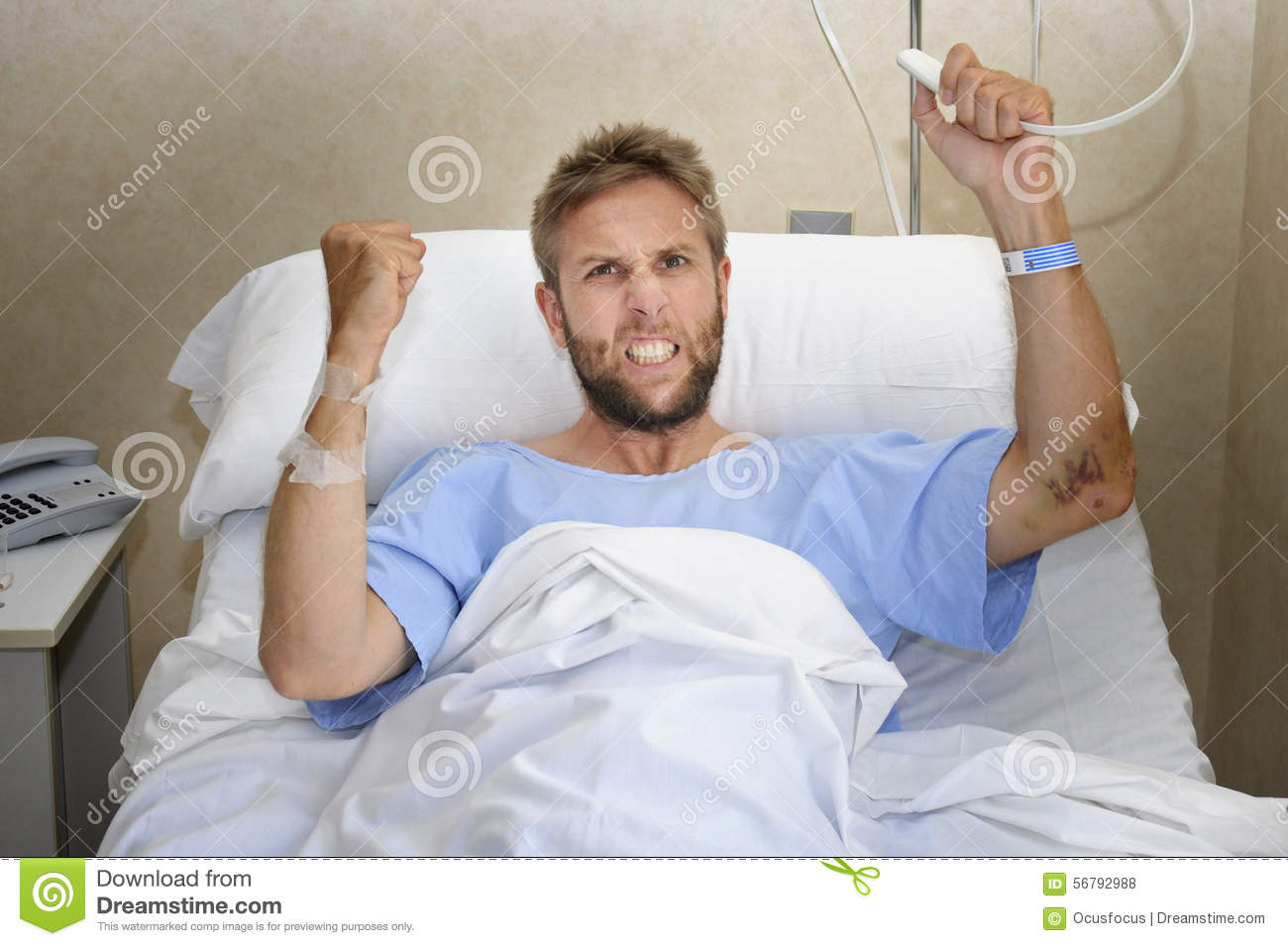 Sick Patient In Hospital Bed : Stock Photo: Angry patient man at hospital room lying in bed pressing ...