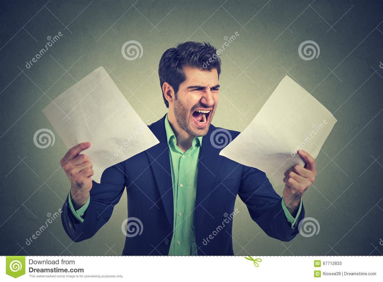 Angry screaming business man with documents papers paperwork