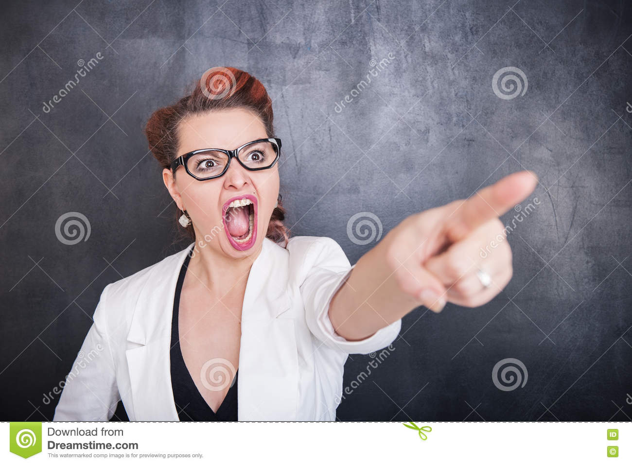 Angry screaming woman pointing out on blackboard background