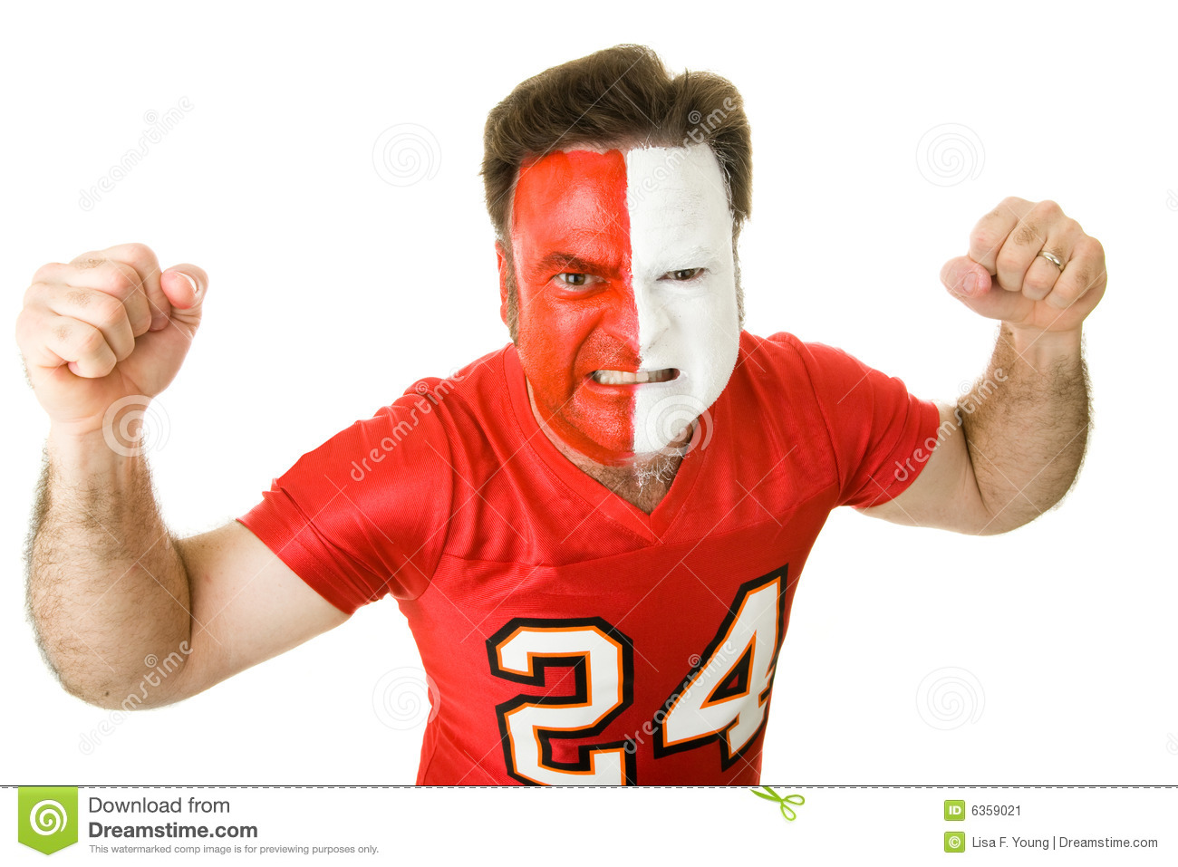 Angry sports fan with a painted face, raising his fists and growling ...