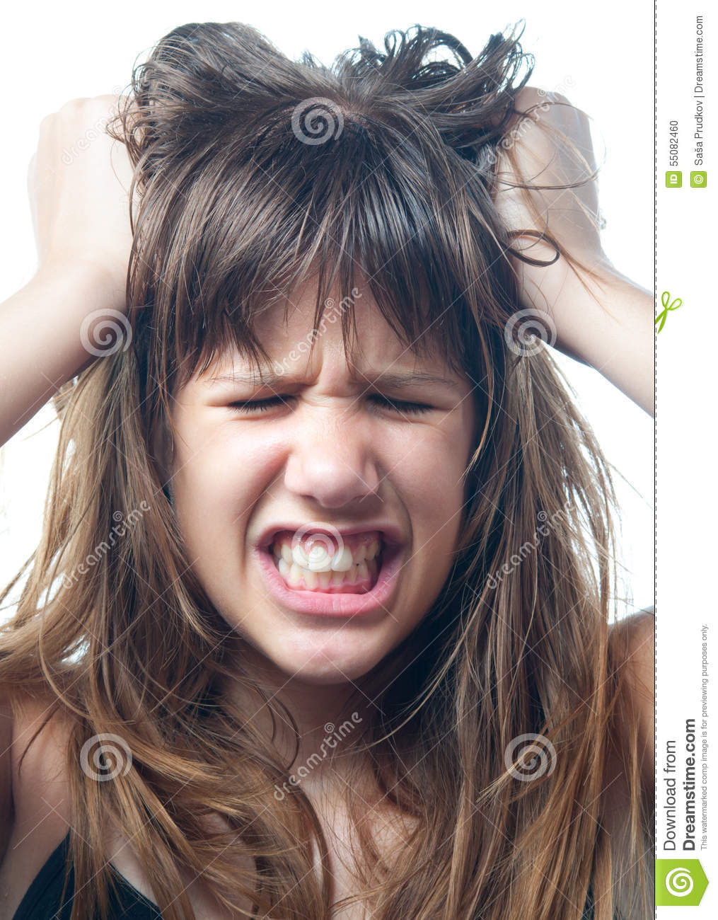 Angry teenage girl screaming isolated on white background