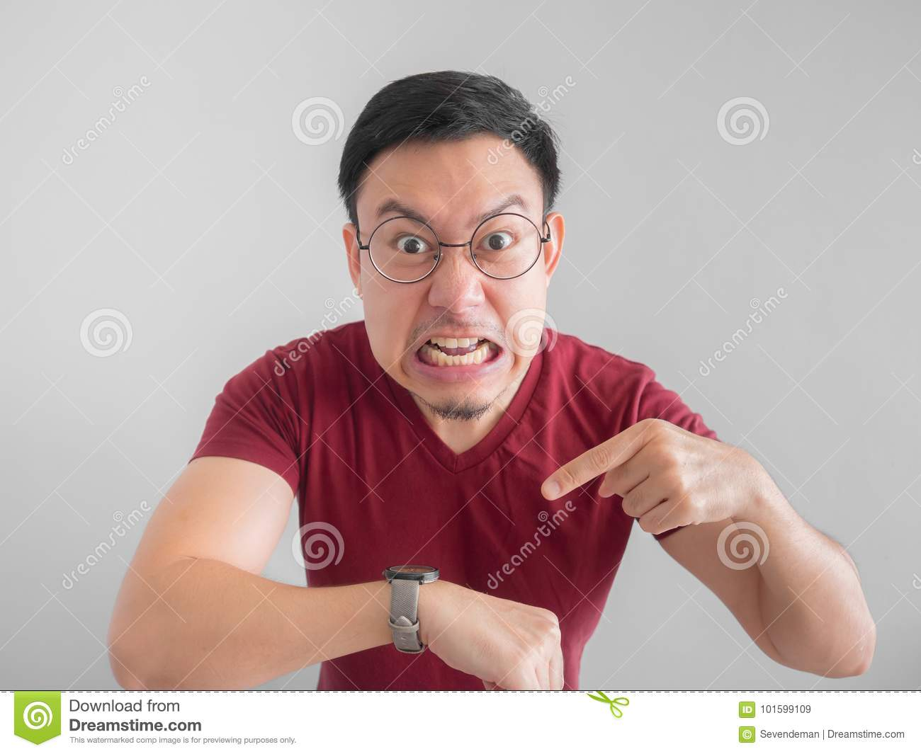 Angry And Unpleasant Face Of Man Is Looking At His Watch