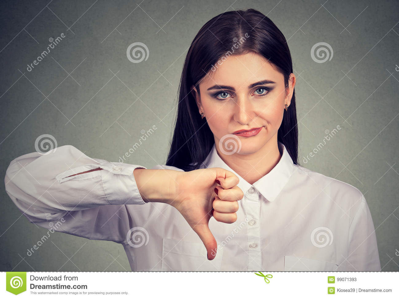 Angry woman giving thumbs down gesture