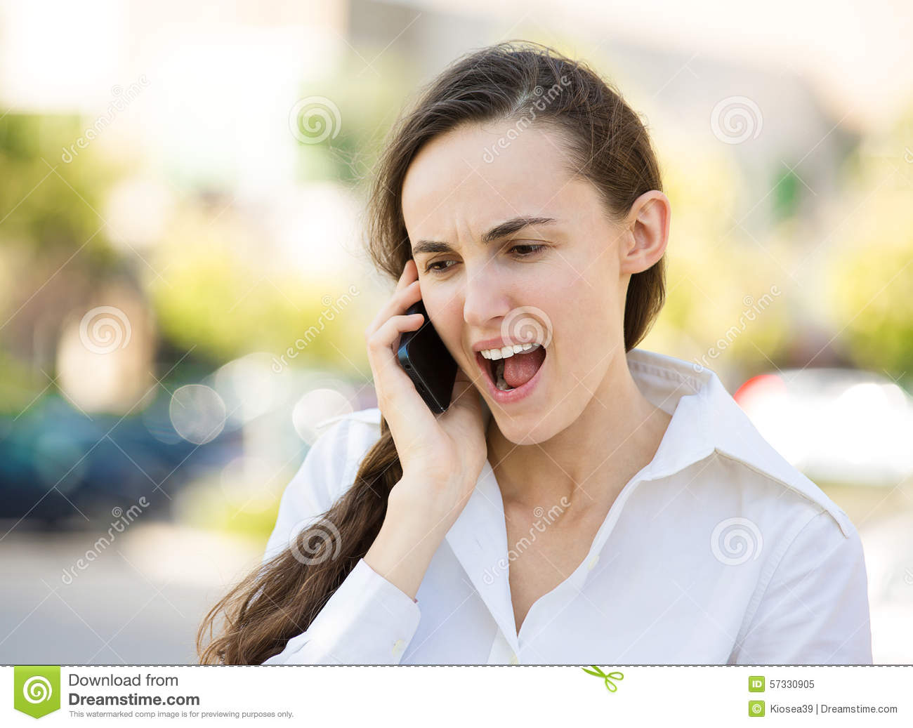Download Angry Woman Talking On A Phone Stock Image - Image of aggravated, lost: 57330905