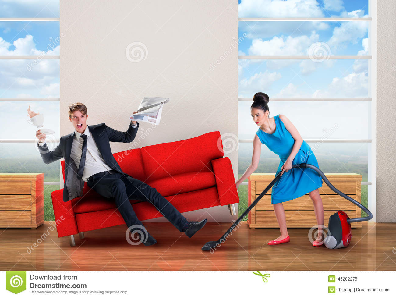 Angry Woman Vacuuming While Man Is Resting Stock Photo - Image ...
