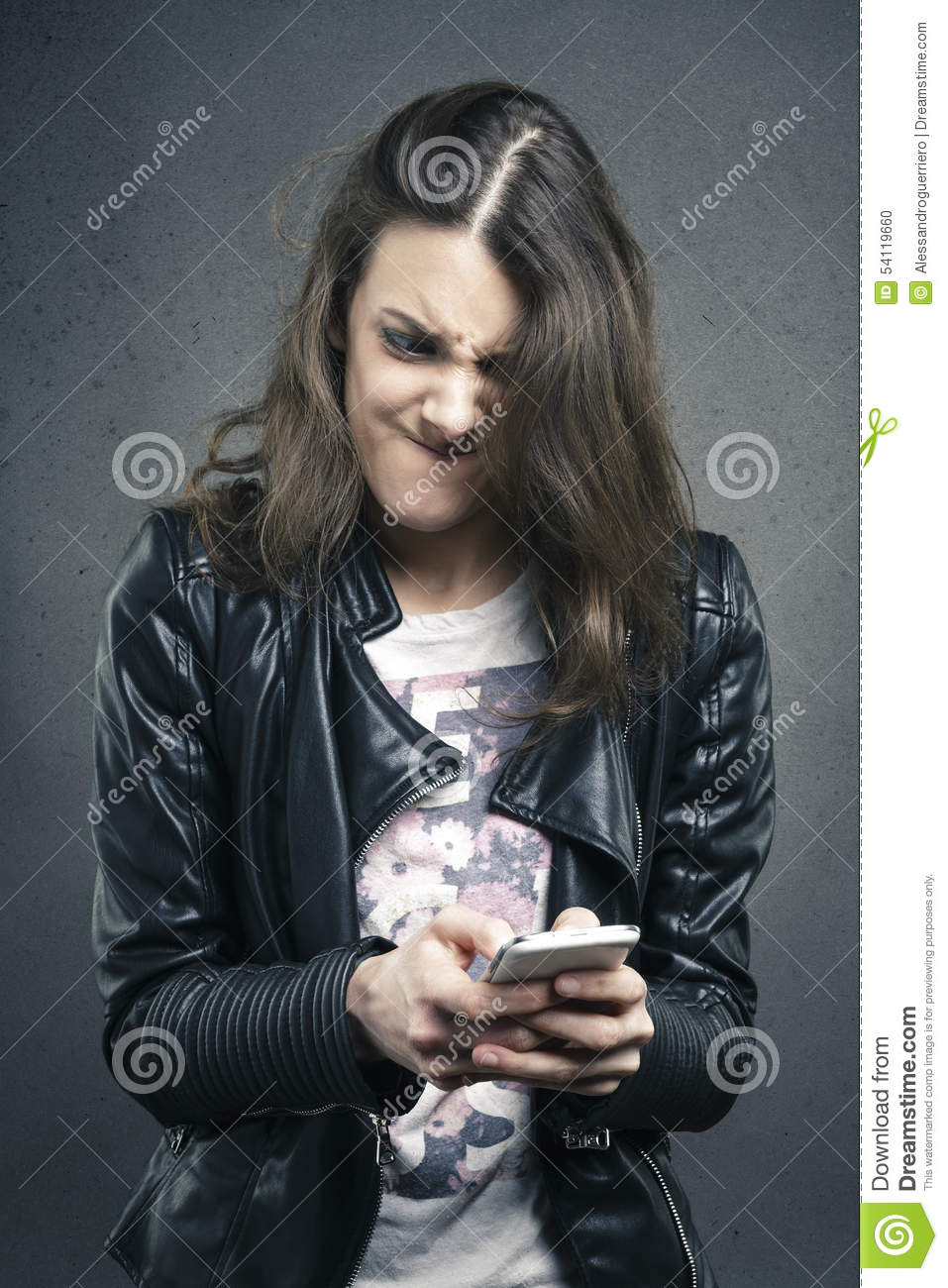 Angry Young Girl Looking At Phone With Disgusting Emotion ... Frustrated Person On Phone