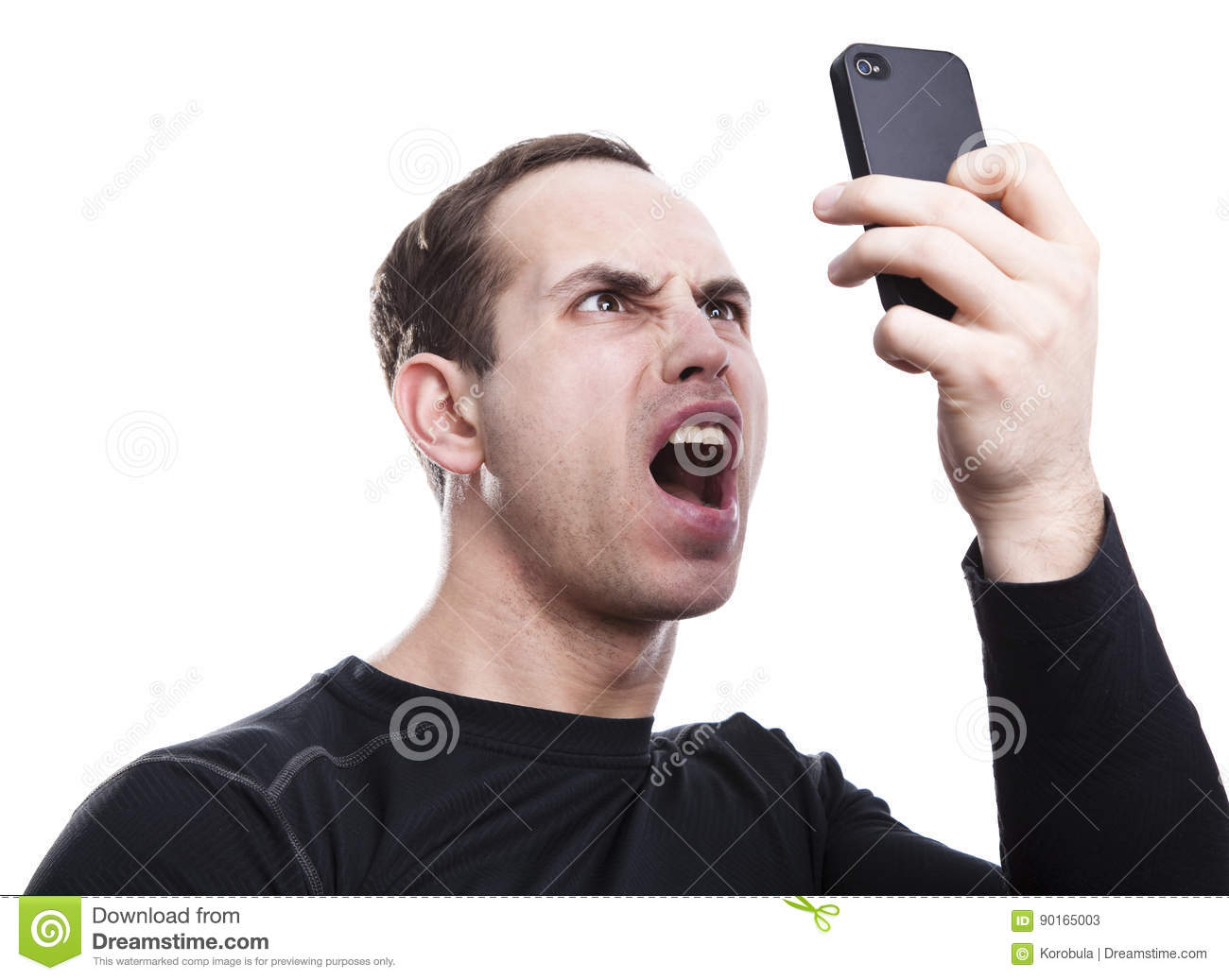 Angry young man talking on smartphone
