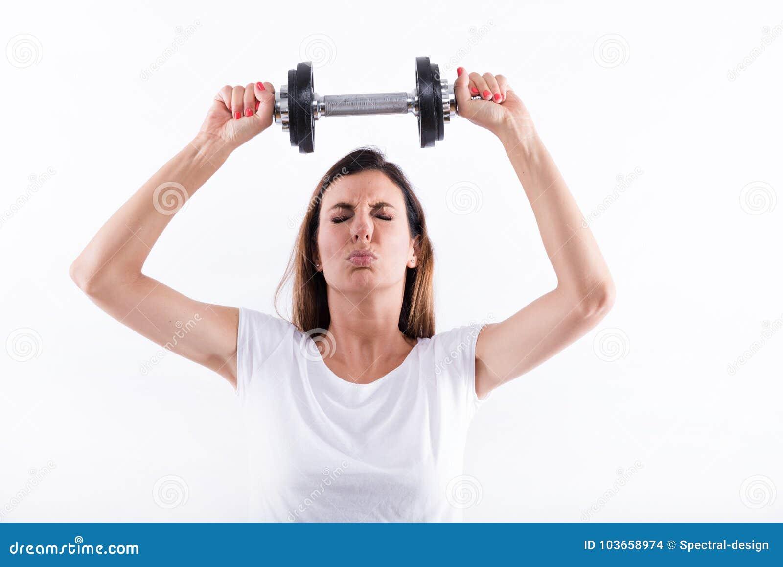 Anhebendes Gewicht Der Jungen Frau Stockfoto - Bild von