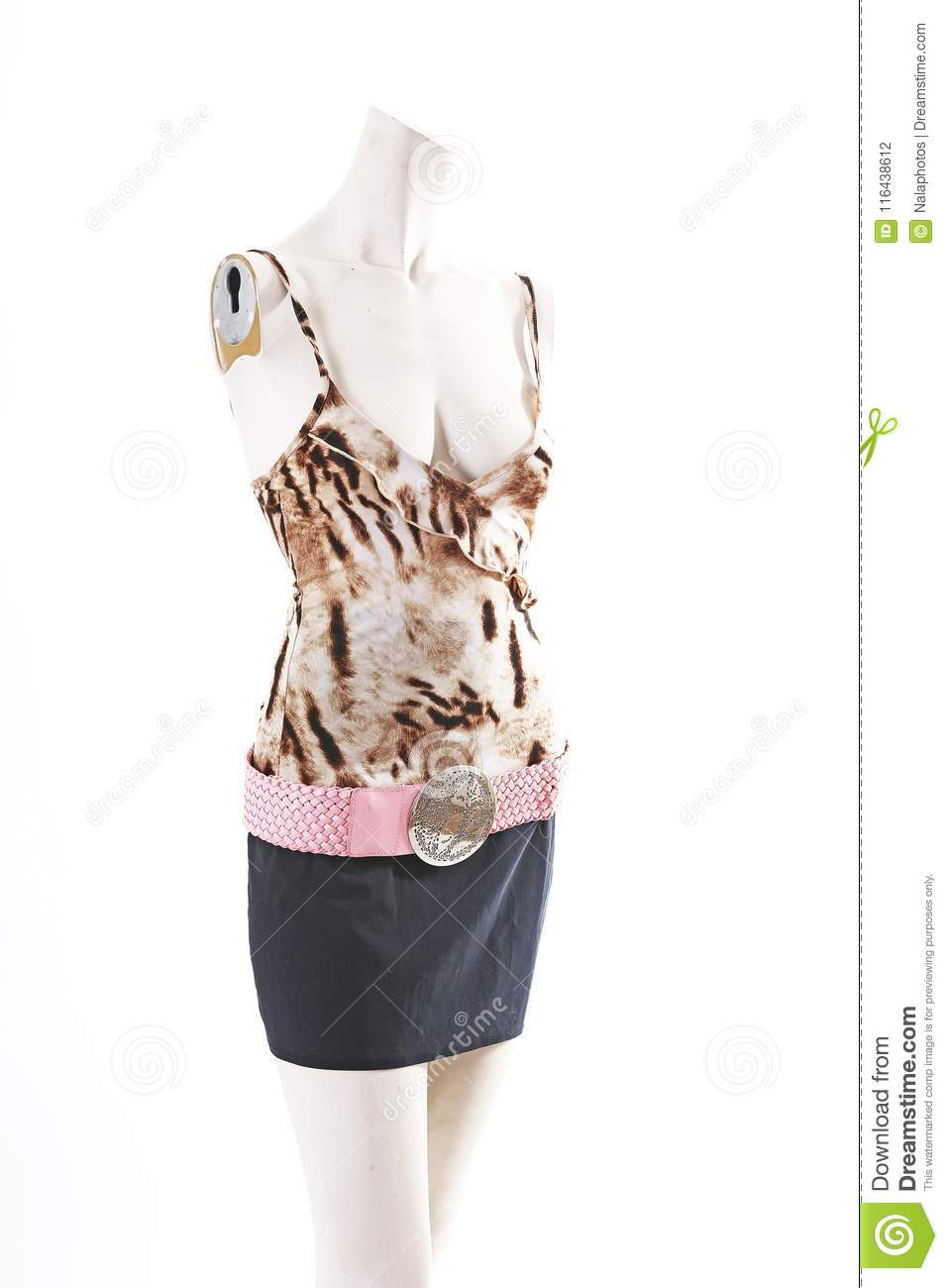 Animal pattern top black skirt on mannequin full body shop display. Woman fashion styles, clothes on white studio background.