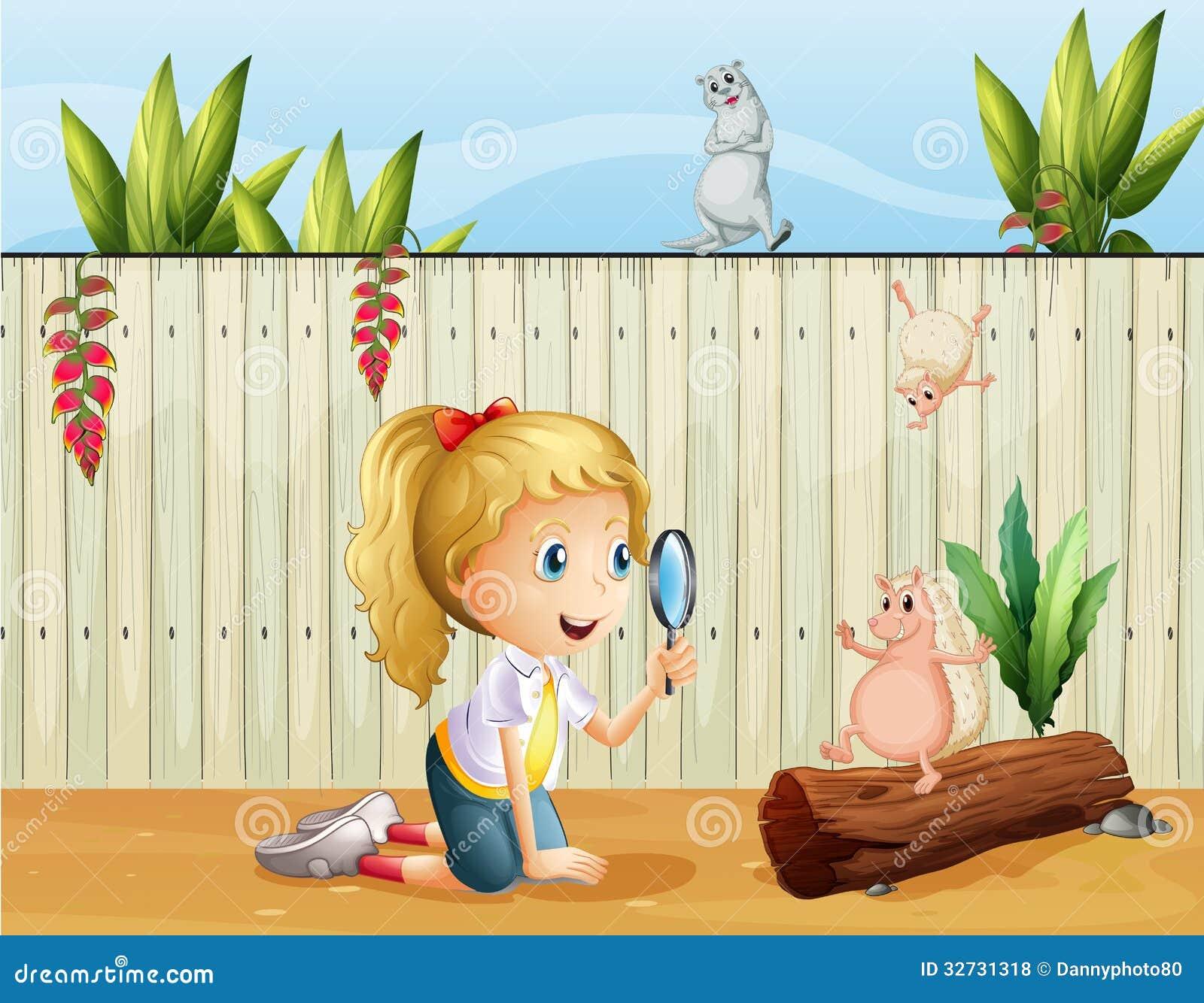 Animales salvajes y una muchacha con una lupa
