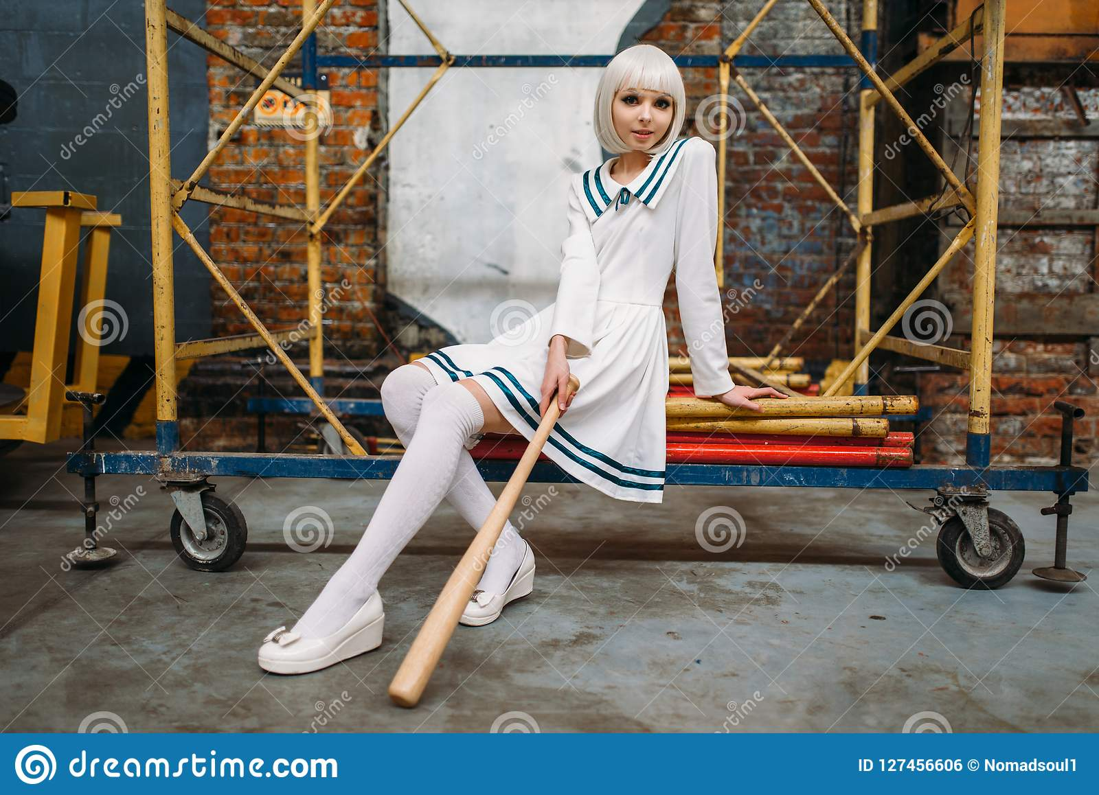 Anime girl with baseball bat, doll in uniform