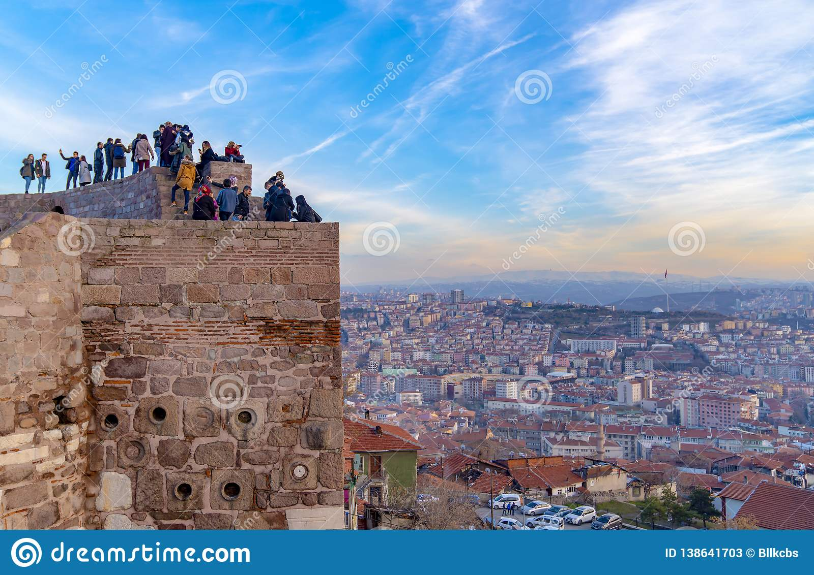 Ankara/Turkey-February 02 2019: Cityscape view from Ankara Castle in the sunset and people enjoying on the top of the castle