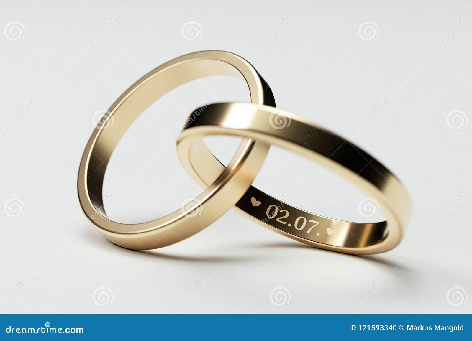 Anneaux de mariage d or d isolement avec la date 2 juillet