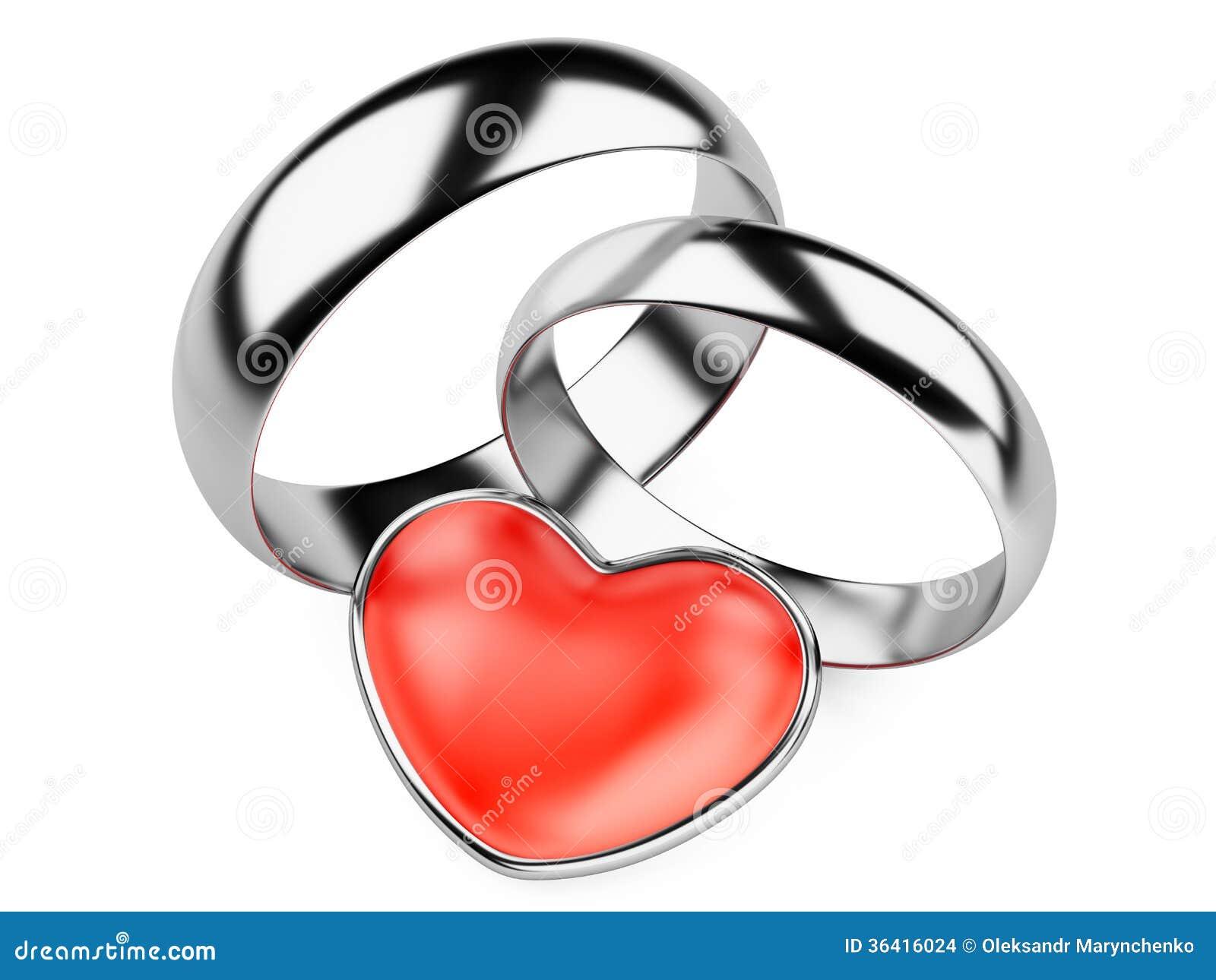 Anneaux de noces dargent et coeur rouge. Disolement sur limage...