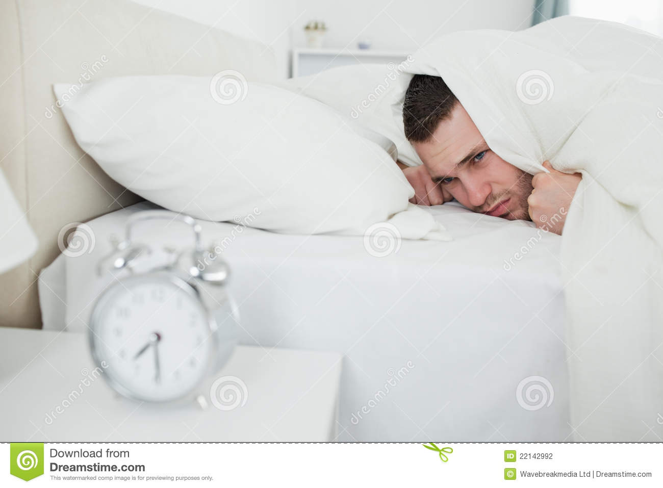 Annoyed Man Being Awakened By An Alarm Clock Stock Photography - Image ...