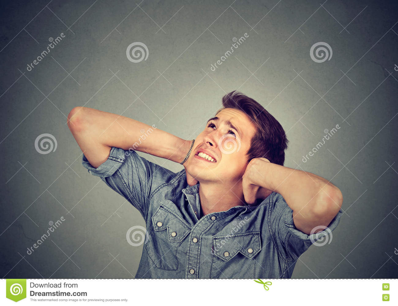 Download Annoyed Stressed Man Covering His Ears Looking Up Stock Image - Image of night, music: 80364501
