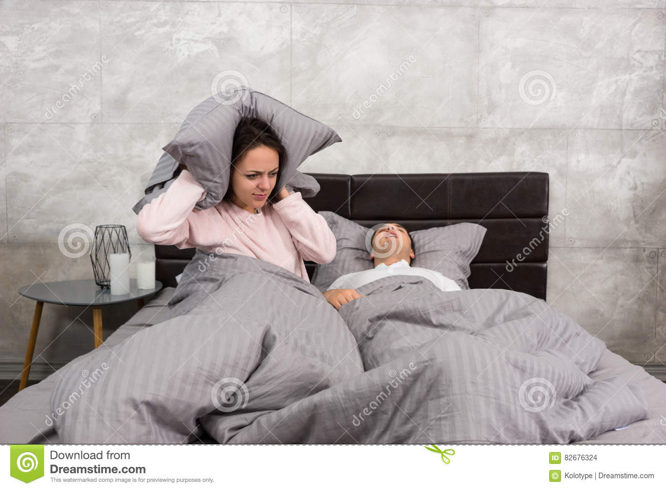Bedroom Colors For Husband And Wife annoyed wife blocking her earsa pillow from noise of husband