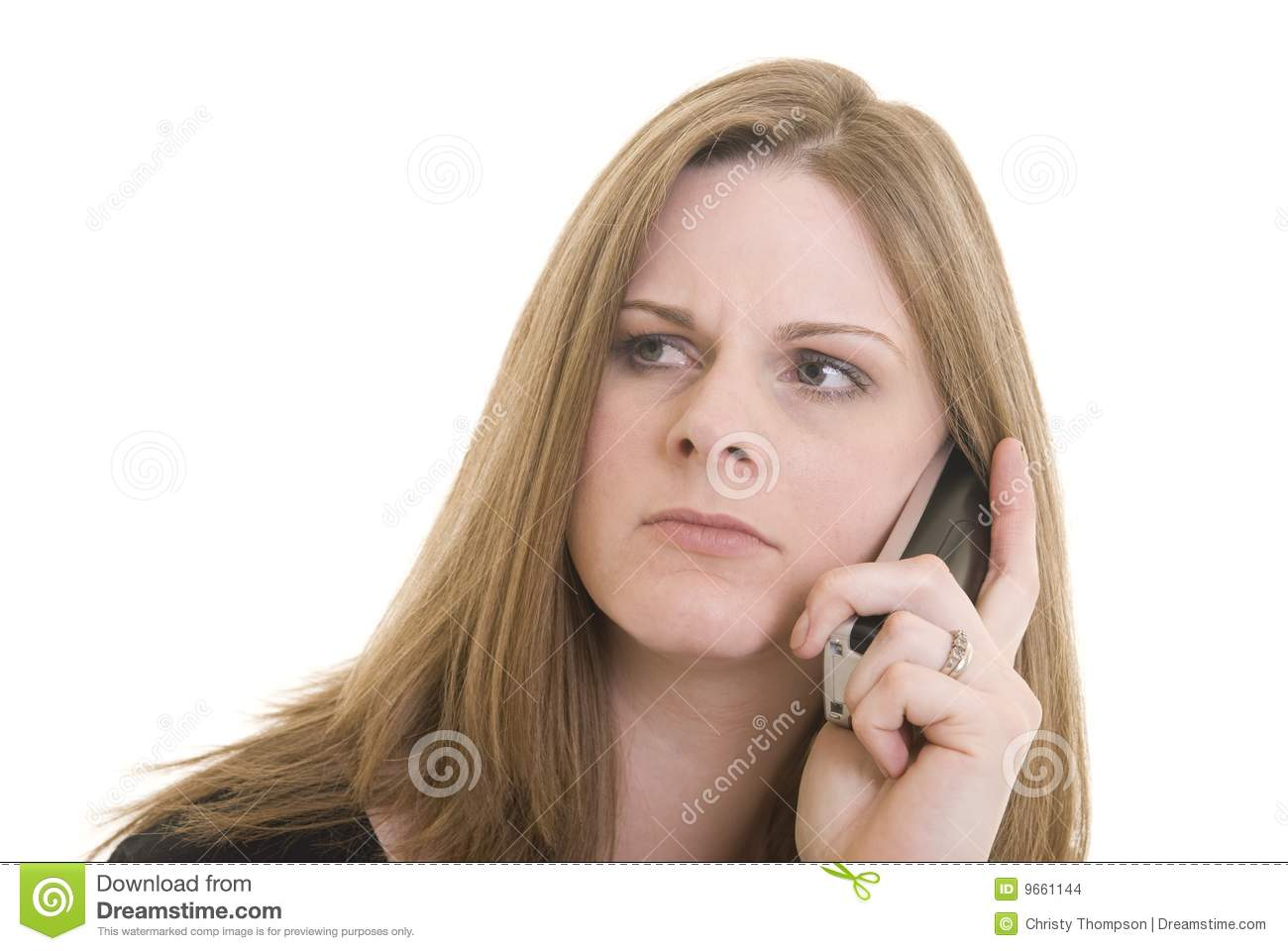 Attractive Caucasian woman with annoyed expression on the phone. Woman