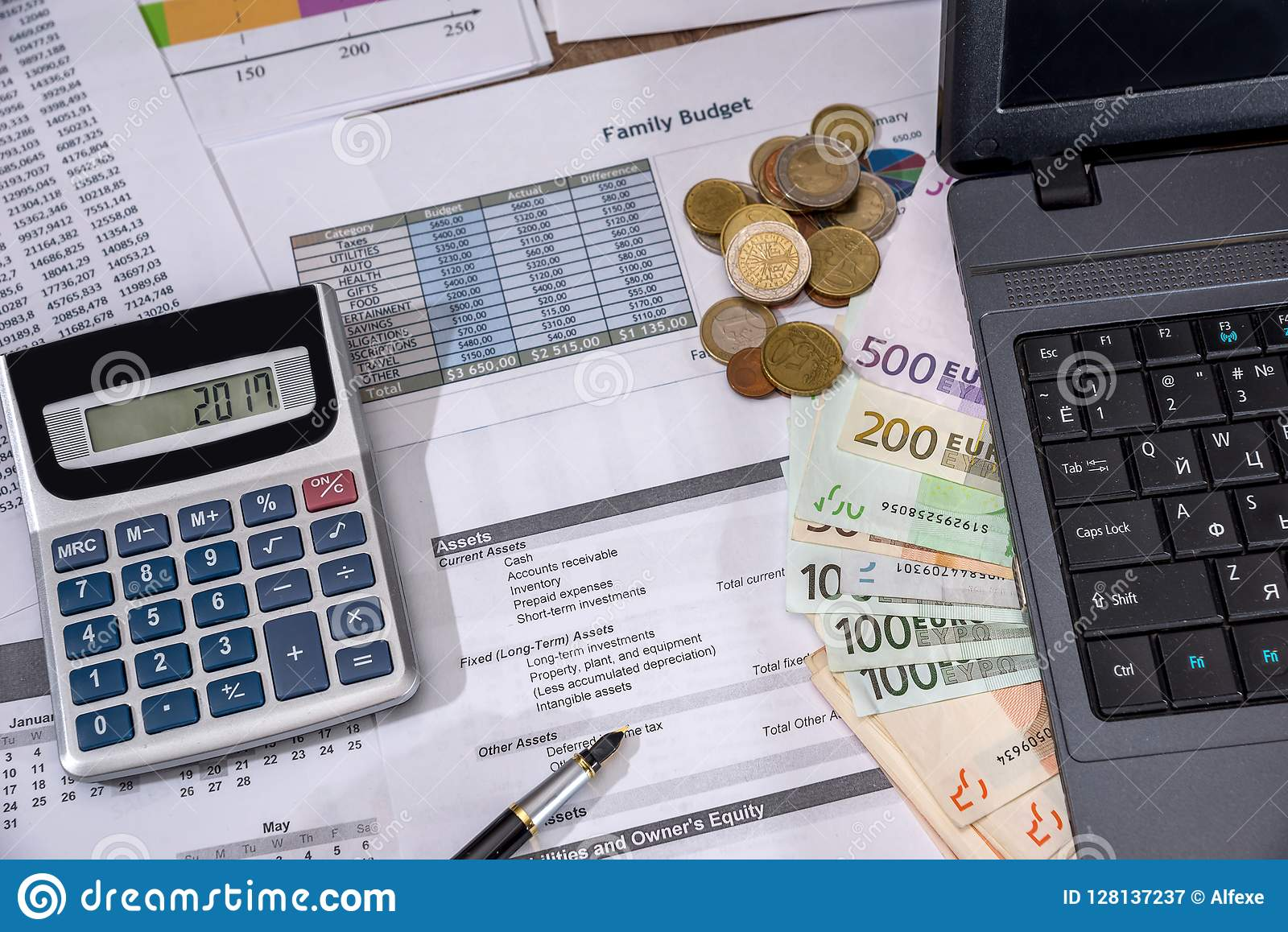 Annual budget, marketing research and business report with laptop, euro bills, coin
