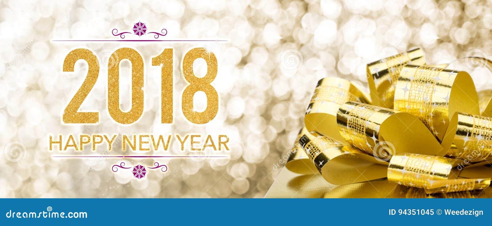 Ano novo feliz 2018 com a caixa de presente dourada com curva grande no sparkli