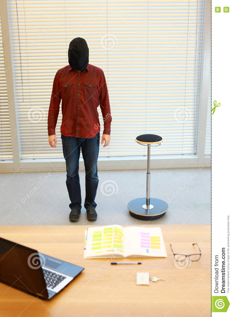 Anonymous man in black sack on head standing in office