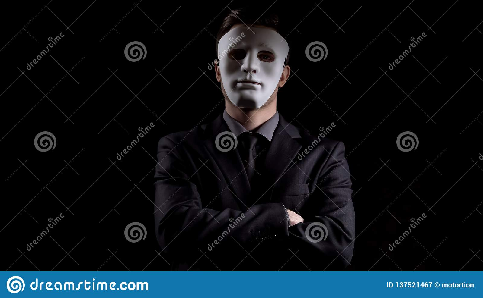 Anonymous man in business suit folding hands, masking personality, hiding income