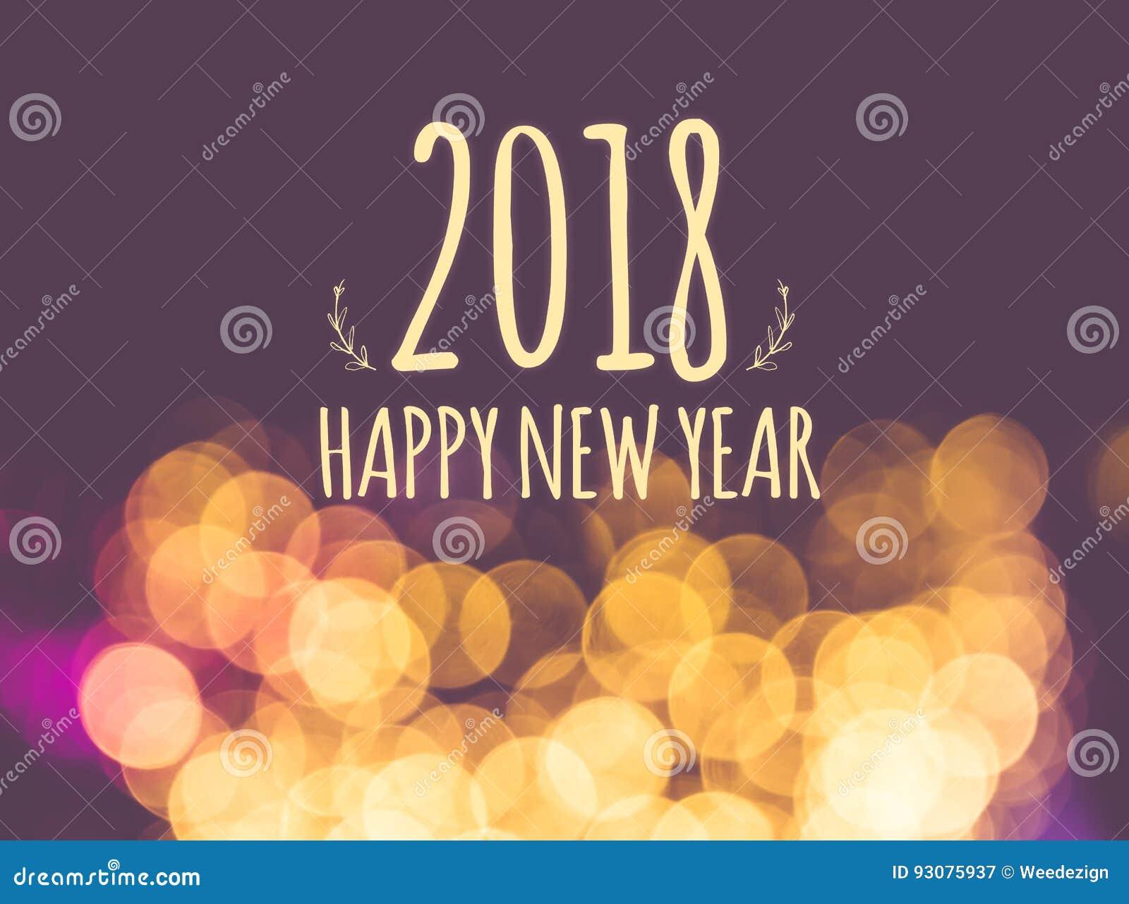 2018 anos novos felizes no backgrou festivo da luz do bokeh do borrão do vintage