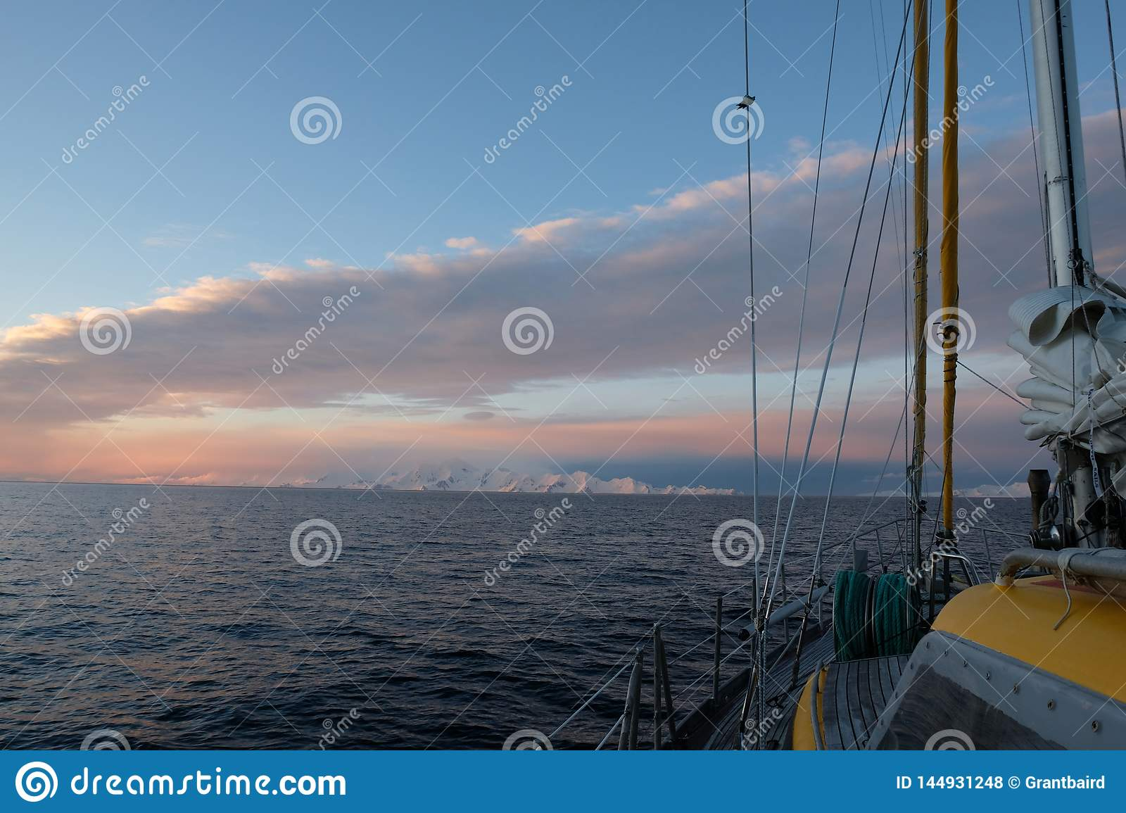 Antarctica sailing under a pink and blue sky