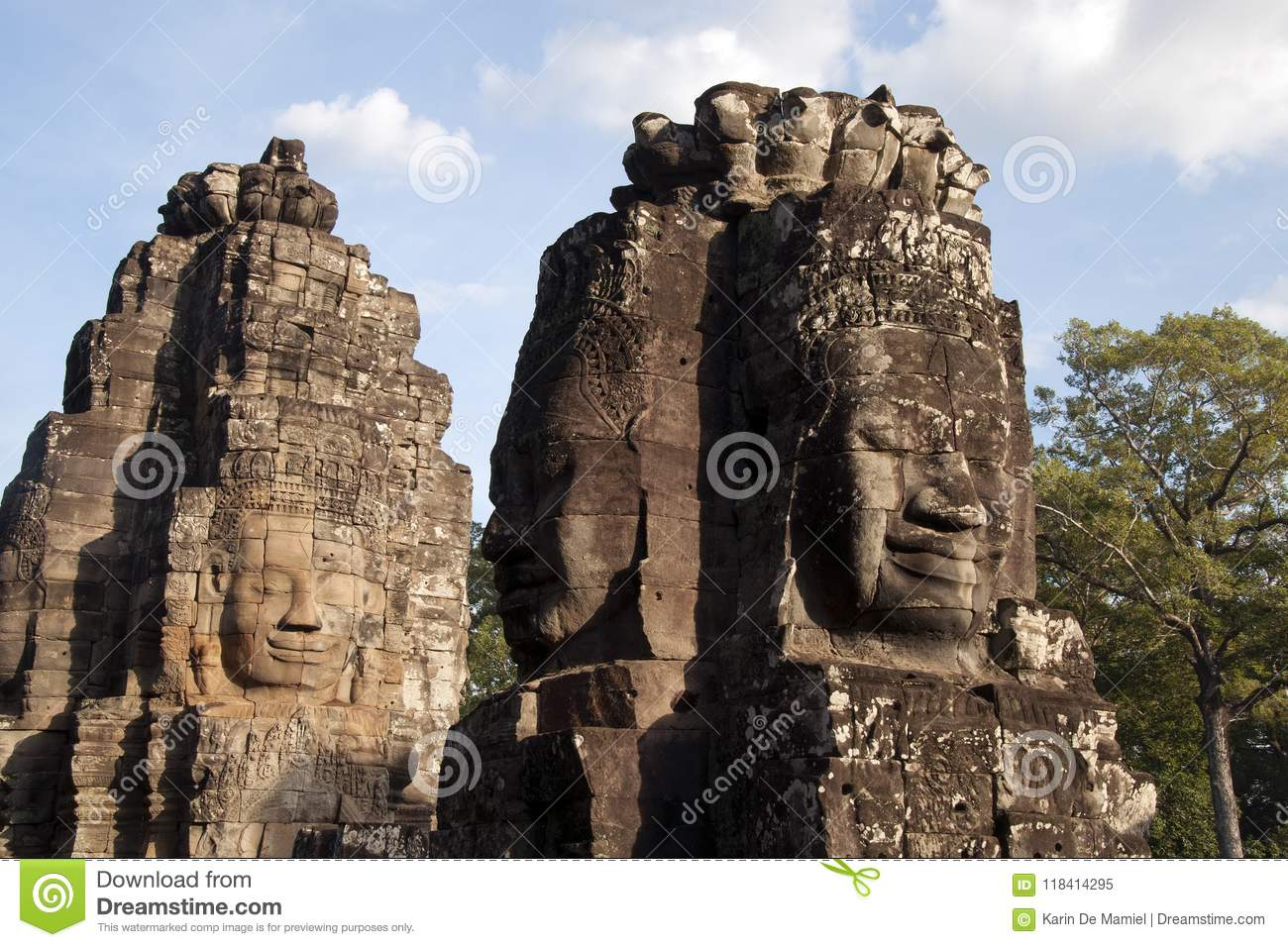 Anthropomorphic faces carved into stone at the Bayon Wat in late afternoon light, a 12th century temple within the Angkor Thom com