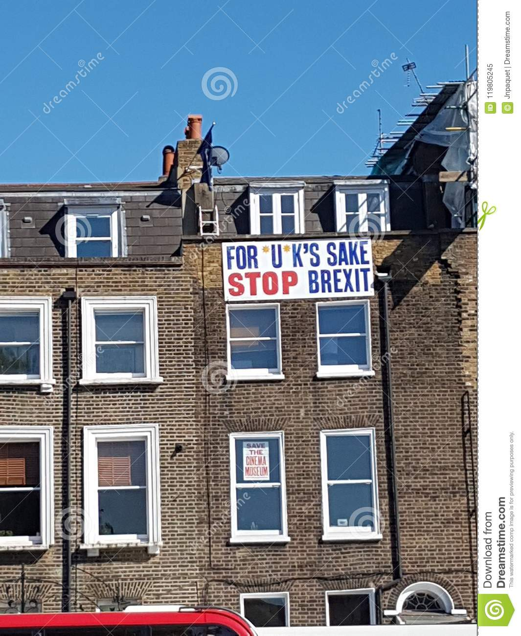 Anti-Brexit banner - For *U*K`s sake, Stop Brexit - at the top of a building in London.
