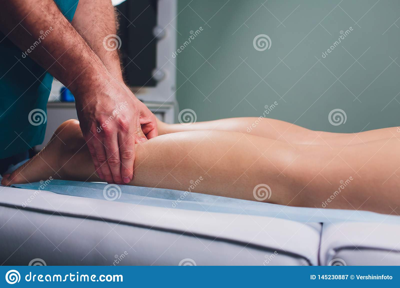 Anti-cellulite massage on the legs of young women.