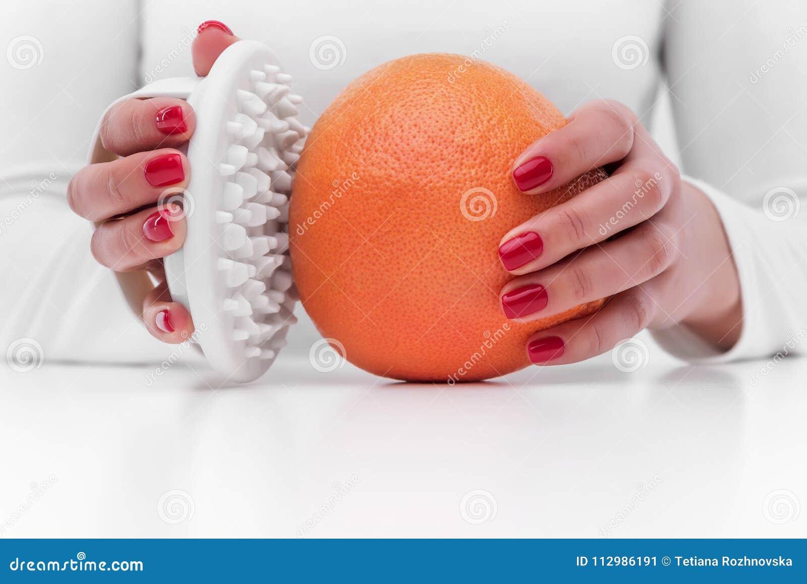 Anti-cellulite massager and orange.