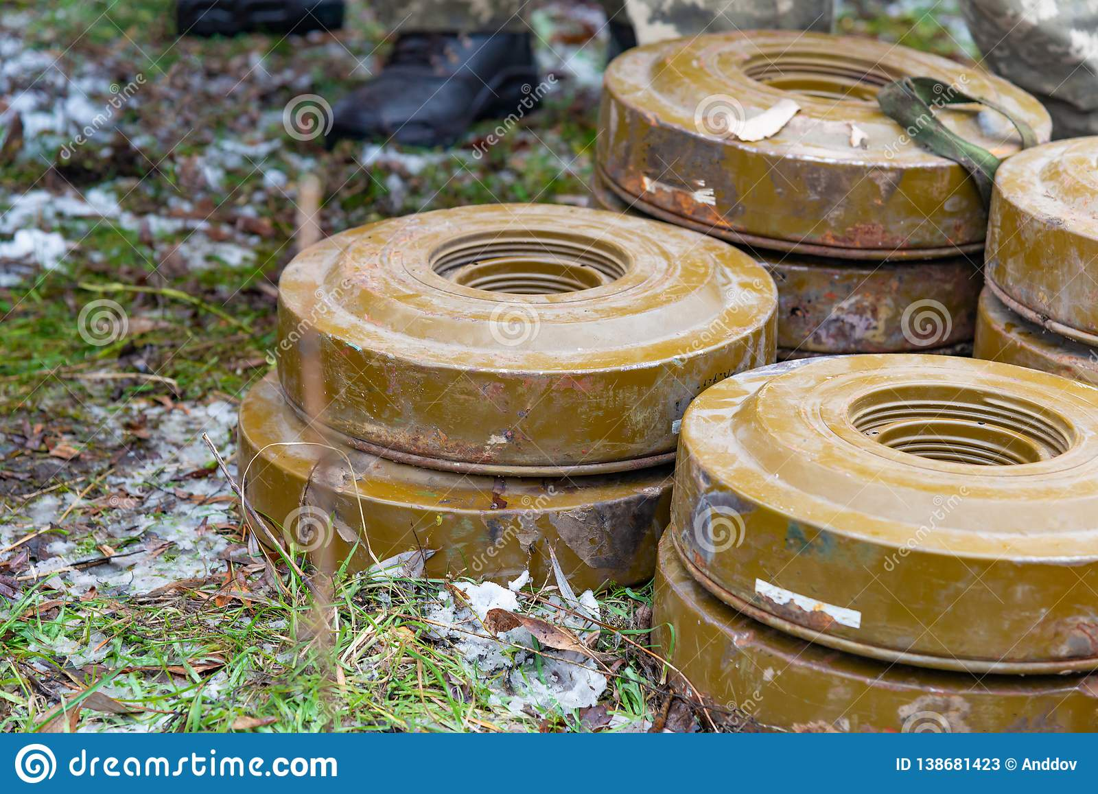 Anti-tank and anti-personnel mines without a fuse lie on the ground