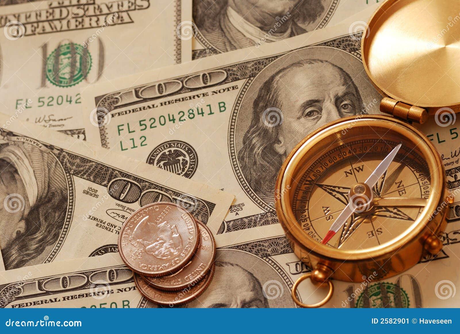 Antiek kompas over geld