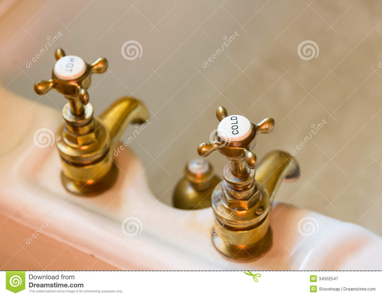 Antique bath taps or faucets. Antique Bath Taps Or Faucets Royalty Free Stock Photography