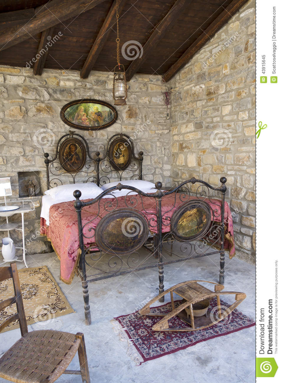 Stock Photo: Antique bedroom in italy with iron bed and bed warmer (or ...
