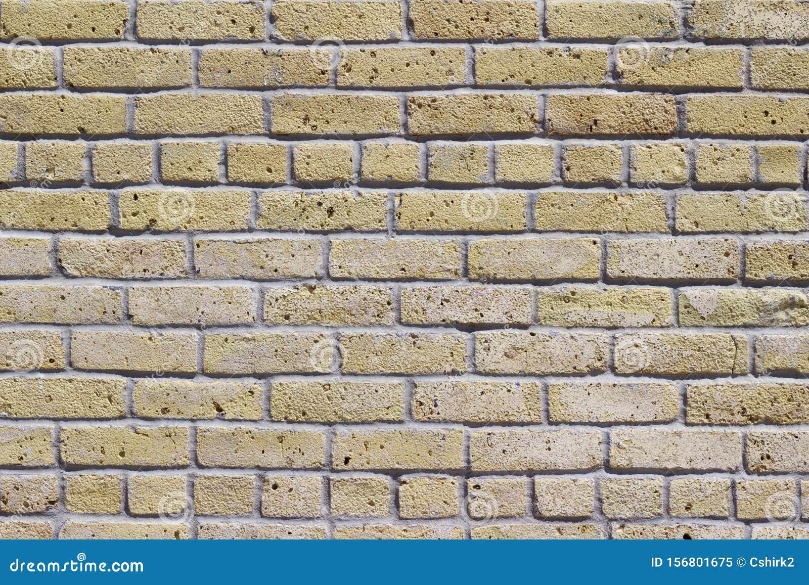 Antique beige brick wall texture in common bond brickwork pattern