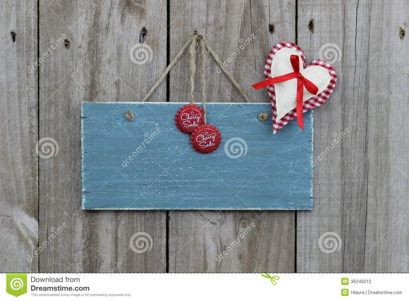 Antique Blue Sign Hanging On Wood Door With Gingham Heart