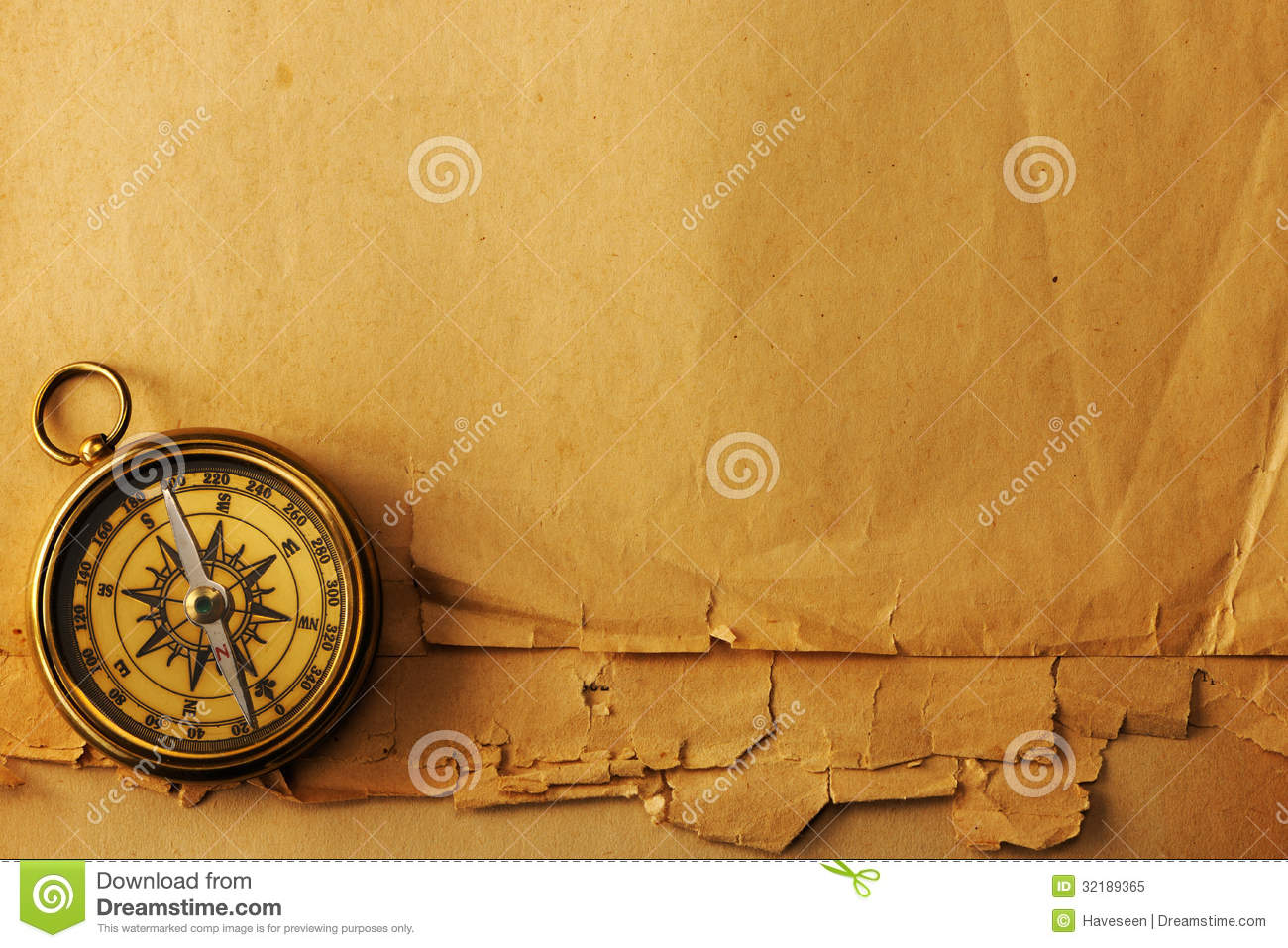 Antique Brass Compass Over Old Background Royalty Free