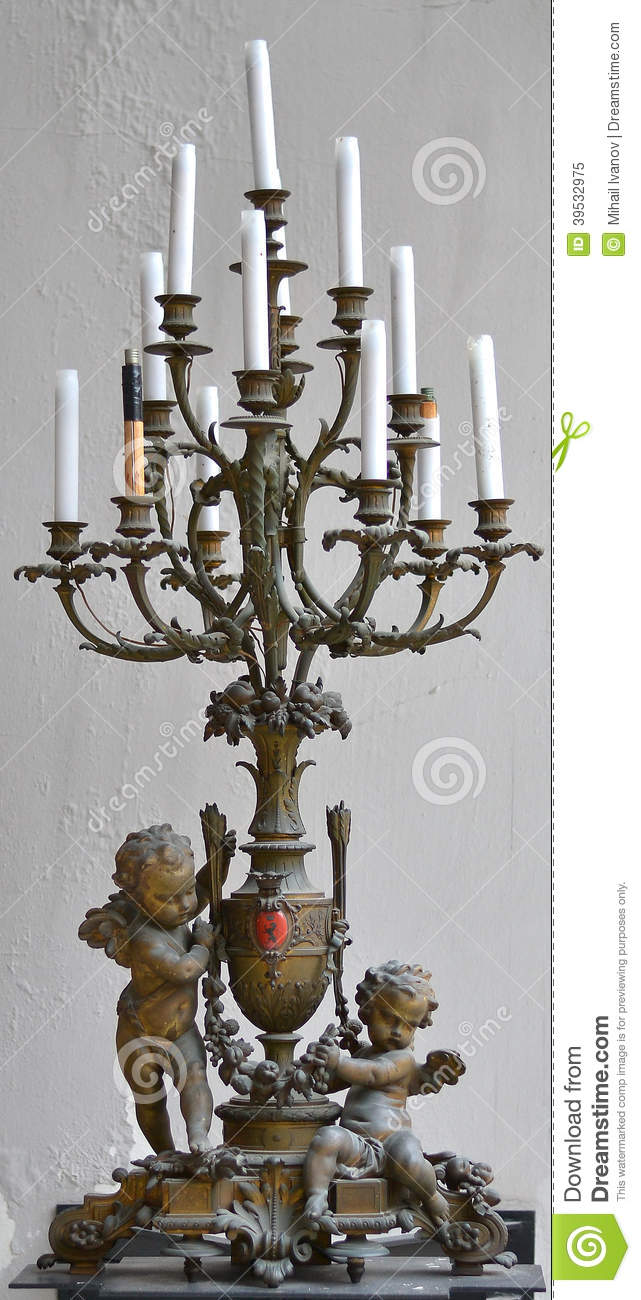 antique candlestick with a cupid angle decor stock photo image 39532975. Black Bedroom Furniture Sets. Home Design Ideas