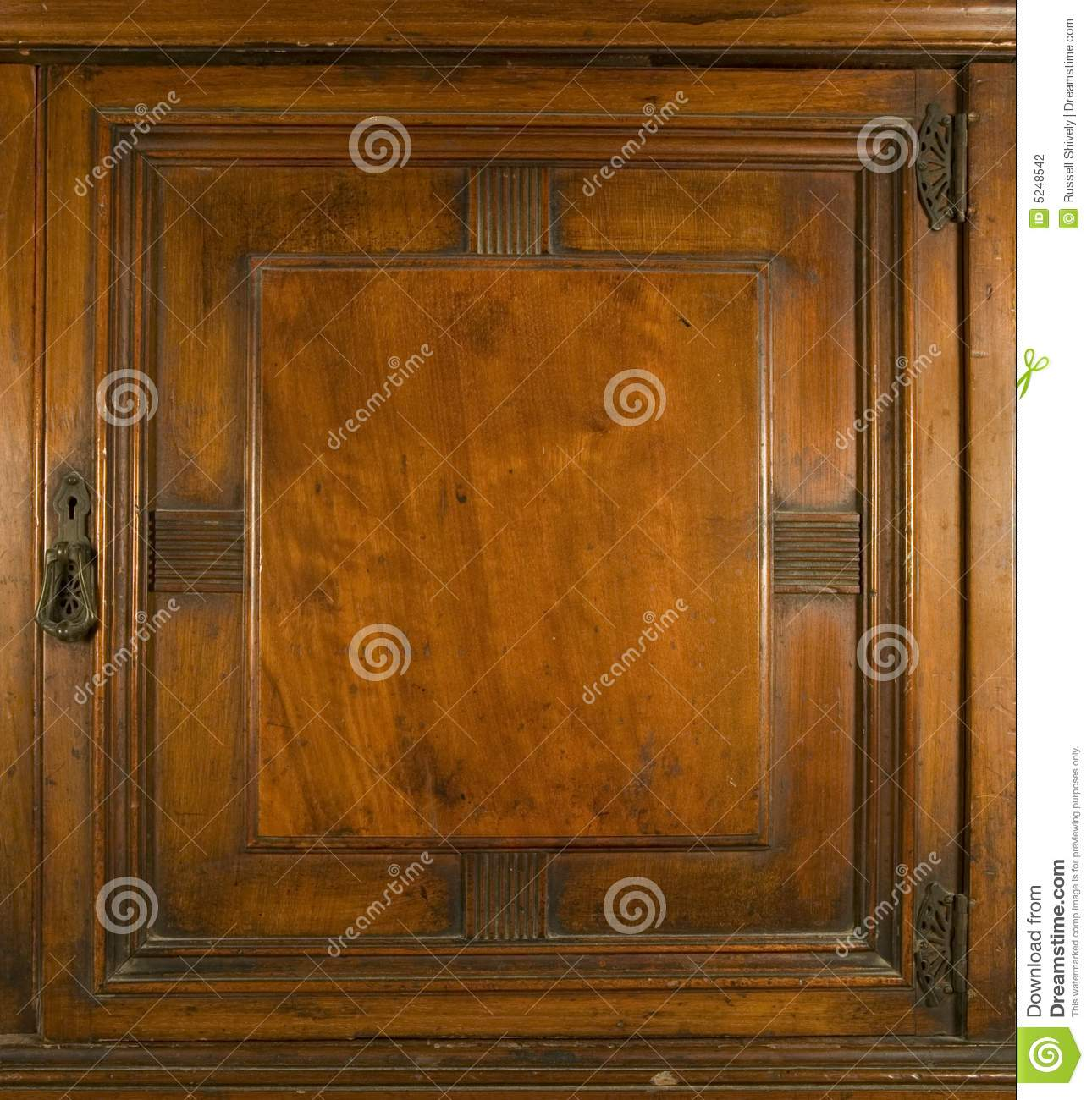 An antique cupboard door with brass keylock and hinges - Antique Cupboard Door With Key Lock Stock Photo - Image: 5248542