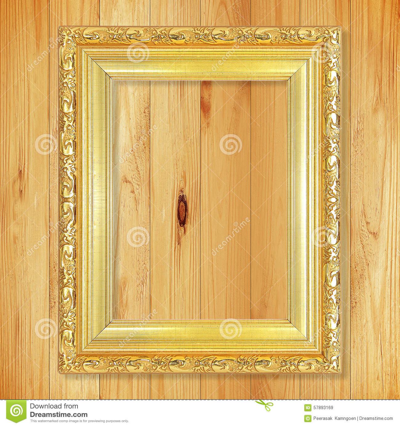 Antique gold frame on wooden wall;. Empty picture frame on woode