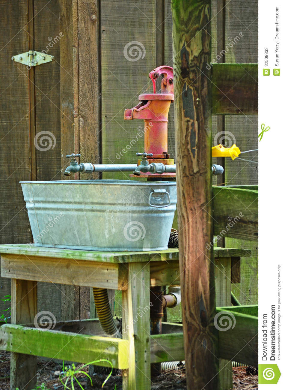 Antique Hand Water Pump Water Spigot Wash Pale Stock Image - Image ...