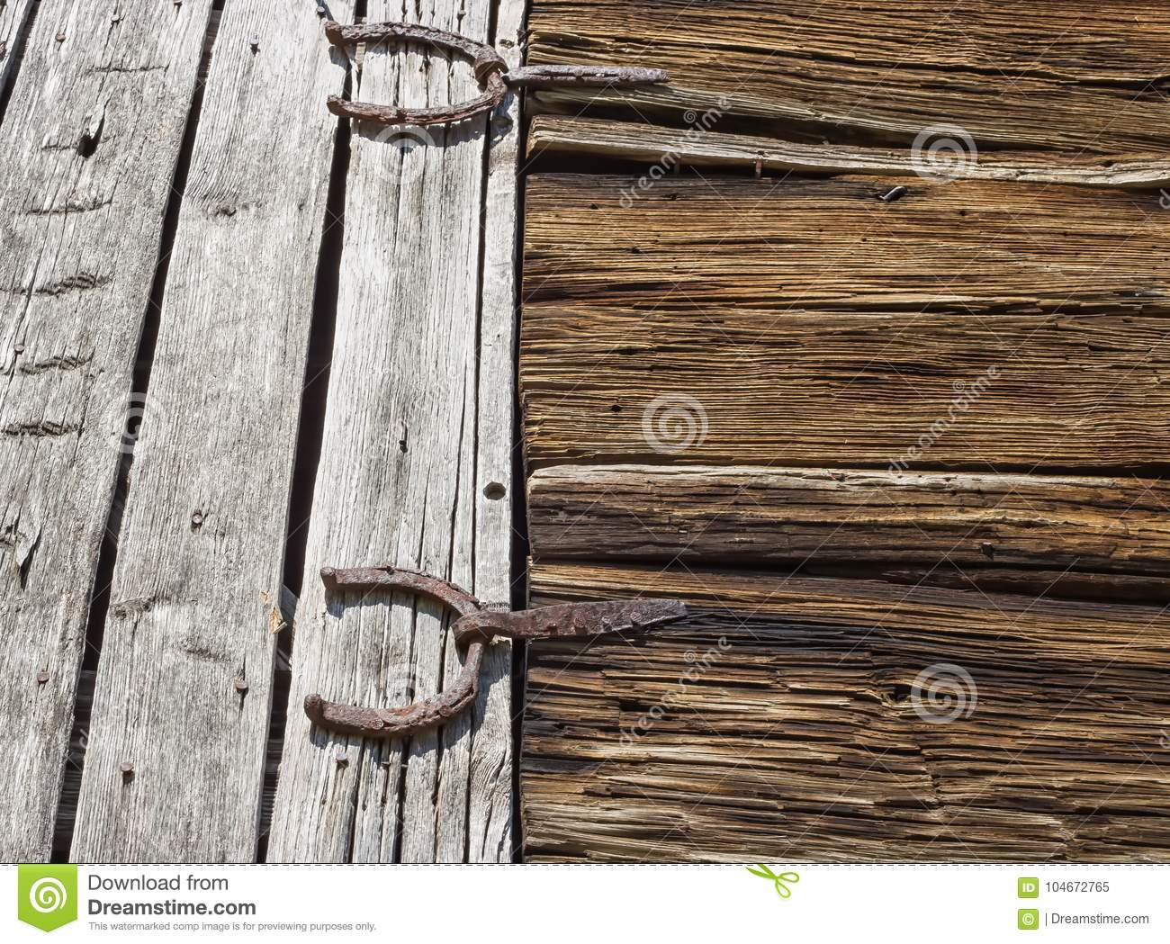 Antique horseshoes as barn door hinges - Antique Horseshoes As Barn Door Hinges Stock Image - Image Of Detail