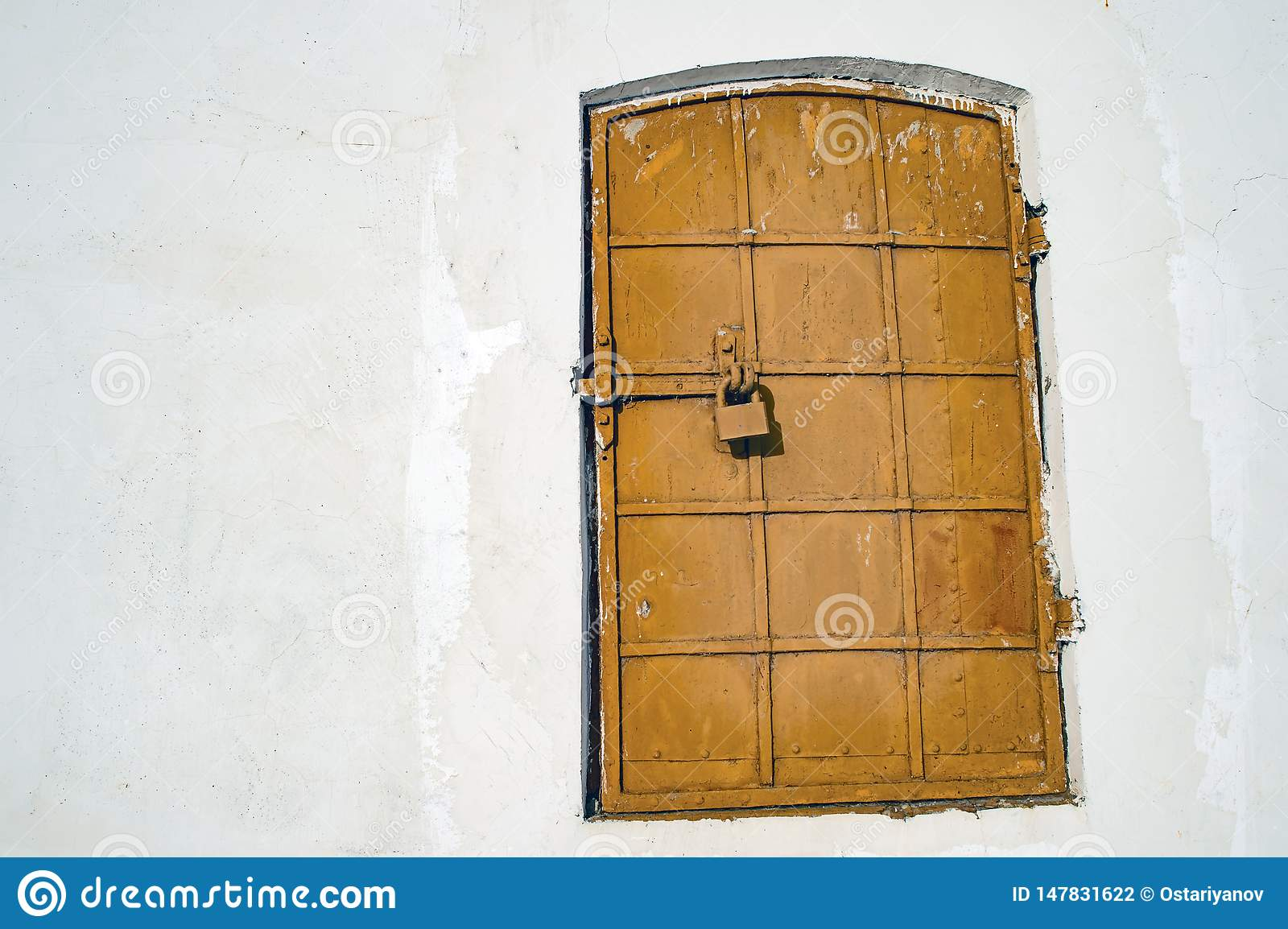 Antique iron-bound window with a latch. Background