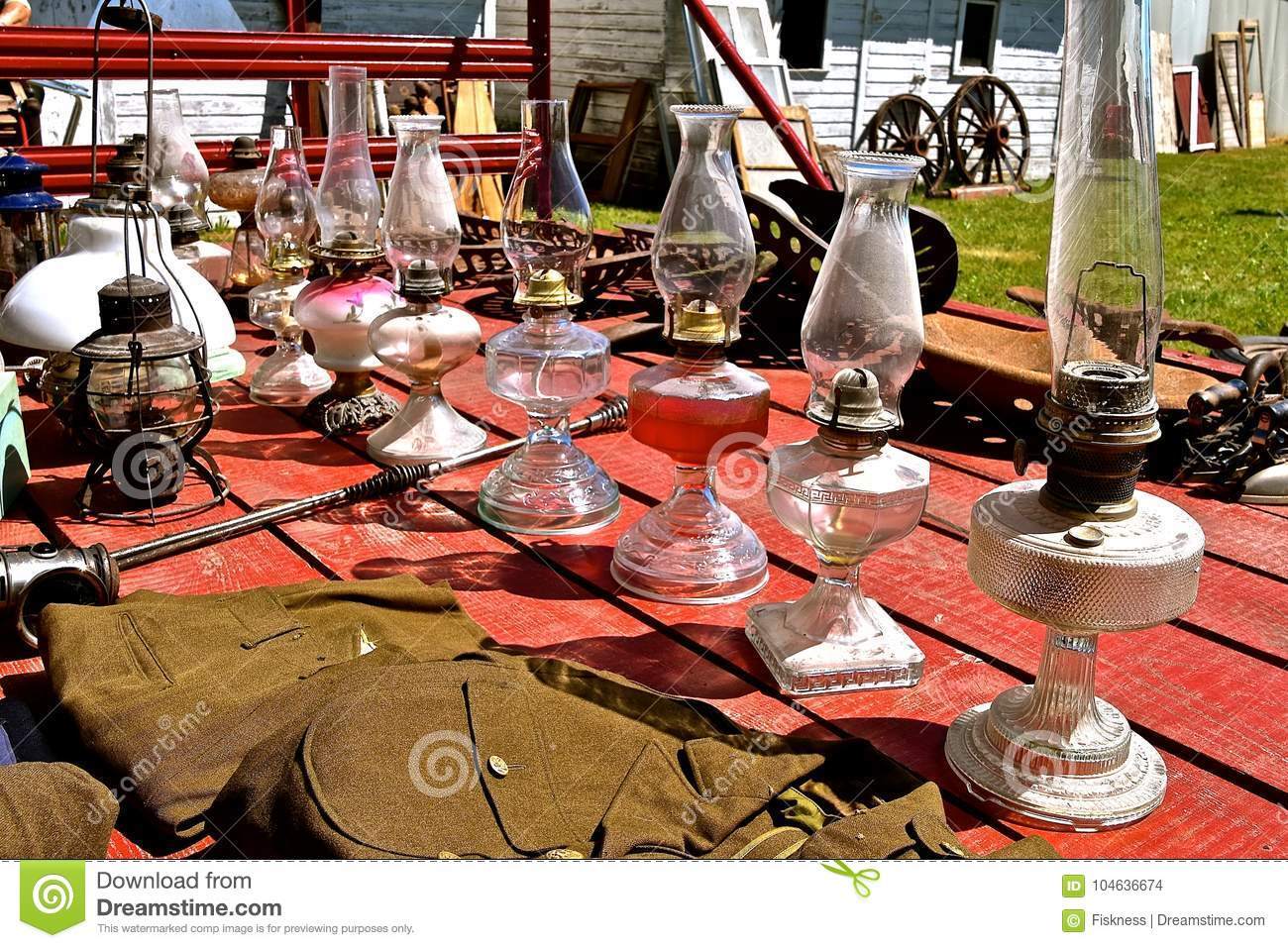 Collection Of Antique Kerosene Lamps At An Auction Stock