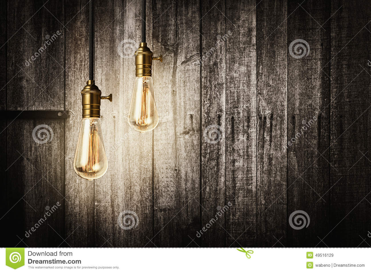 antique light bulbs on wooden background stock image