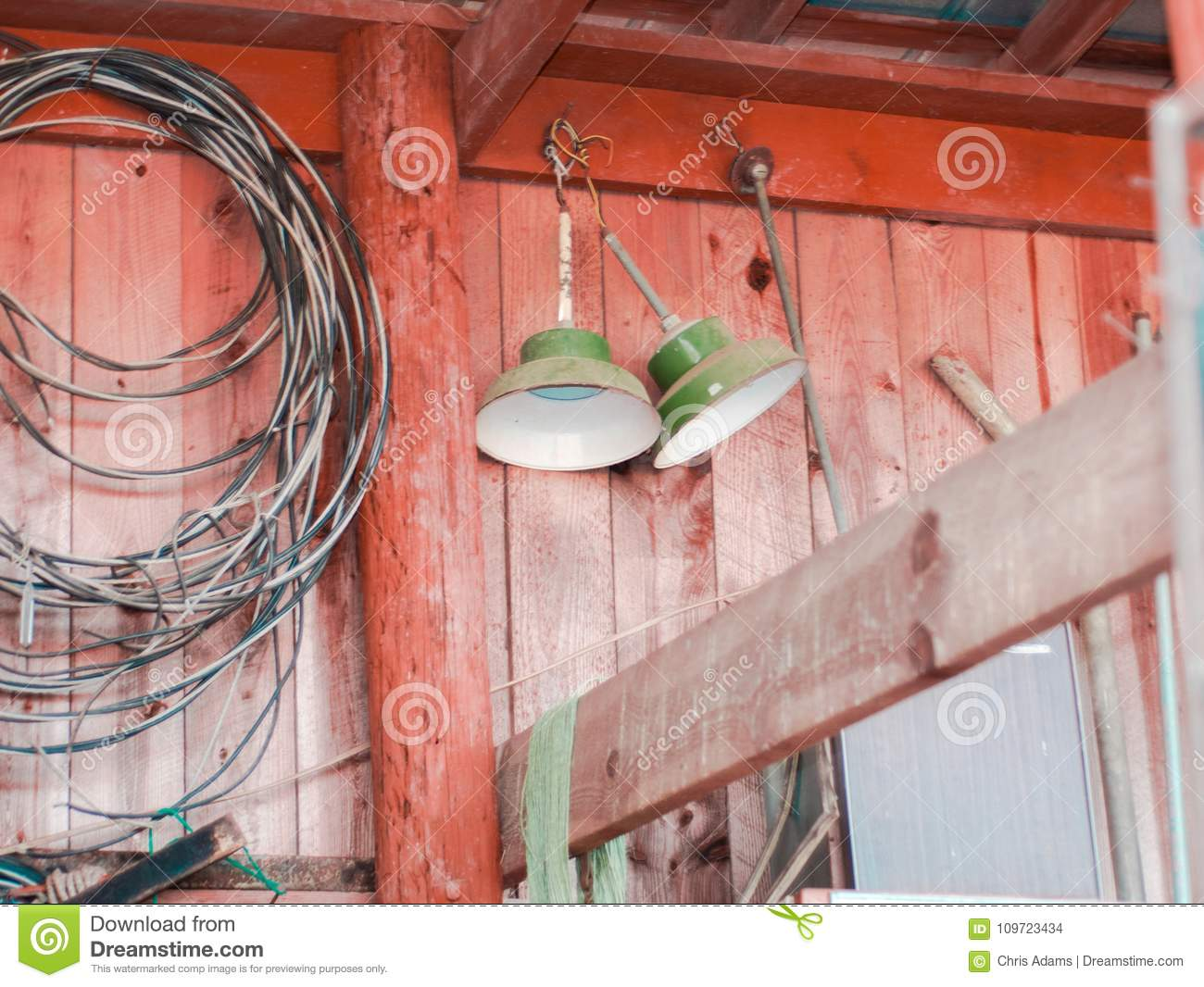 Antique Lights Hanging In A Barn Stock Photo - Image of shot, focus ...