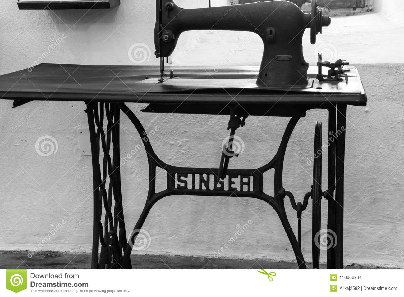An antique manual `Singer` treadle sewing machine